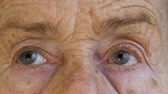 starość : Close-up  shoot of face and eyes of elderly woman aged 81 years