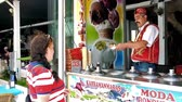 porta : ANTALYA, TURKEY - MAY 13, 2017: The girl is careful of tricks of the ice cream vendor, in Turkish resorts they often jokes with client, showing some fun hand tricks, on May 13 in Antalya.