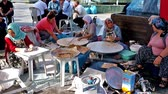 gozleme : ANTALYA, TURKEY - MAY 13, 2017: The group of women prepares gozleme (local flat bread) in the street during the fair in old town, on May 13 in Antalya. Stock Footage