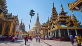 dagon : YANGON, MYANMAR - FEBRUARY 27, 2018: The way from the North entrance to the great golden Stupa of Swedagon with numerous scenic pavilions and image houses from both sides, on February 27 in Yangon. Stock Footage