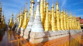 santuário : The group of golden stupas of Inn Thein Buddha image Shrine, located on the hilltop in Indein (Inn Thein) village, Inle Lake, Myanmar.