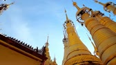 santuário : The tall golden stupas of Inn Thein Buddha image Shrine with beautiful hti umbrellas, decorated with bells, Indein (Inn Thein) village, Inle Lake, Myanmar.