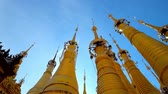 santuário : Rotating golden stupas with  hti decorative umbrellas, located in Inn Thein Buddha image Shrine, Indein (Inn Thein) village, Inle Lake, Myanmar.