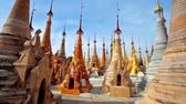township : The rows of small stupas, decorated with hti decorative umbrellas and bells in archaeological and religious site of Shwe Inn Dein Pagoda, Inn Thein (Indein) village, Inle Lake, Myanmar.