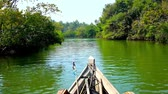 saline : Kayak floating along the narrow creek of Kangy river amid the lush mangrove thickets, Chaung Tha, Myanmar.