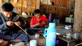 splitting : CHAUNG THA, MYANMAR - MARCH 1, 2018: The family of Burmese farmers at daily work - people split the bamboo for weaving, sitting on the floor of their small chamber, on March 1 in Chaung Tha.