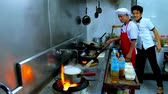 wok dishes : CHAUNG THA, MYANMAR - FEBRUARY 28, 2018: The cooks prepare seafood in kitchen of tourist restaurant, on February 28 in Chaung Tha. Stock Footage