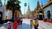 dagon : YANGON, MYANMAR - FEBRUARY 27, 2018: Visit magnificent Shwedagon Pagoda with huge golden stupa, richly decorated pavilions and masterpiece statues, sculptures and carvings, on February 27 in Yangon