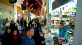 agd : KASHAN, IRAN - OCTOBER 22, 2017: The crowd of locals at the food stall of Grand Bazaar, people buy cereals, nuts, seeds and other products, on October 22 in Kashan. Wideo