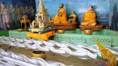 doar : BAGO, MYANMAR - FEBRUARY 15, 2018: The moving installation on religious theme in Shwemawdaw Pagoda pavilion - the dragon appears from stormy waters and hides in waves, on February 15 in Bago.