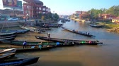 canoe : NYAUNGSHWE, MYANMAR - FEBRUARY 20, 2018: The busy tourist harbor with numerous kayaks, offering trips to Inle Lake, on February 20 in Nyaungshwe.