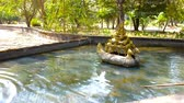 rendilhado : The fountain in garden of Kanbawzathadi Palace is decorated with sculpture of Karaweik Barge - the boat in shape of mythical bird (Brahmin Duck) for carrying Buddha images, Bago, Myanmar.