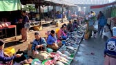 inlay : NYAUNGSHWE, MYANMAR - FEBRUARY 20, 2018: The busy morning in Mingalar Market - fish sellers offer fresh catch, clients walk along the market alley and choose foods, on February 20 in Nyaungshwe.
