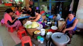 vermicelli : POPA, MYANMAR - FEBRUARY 26, 2018: The food sellers offer tasty dishes of Burmese cuisine in market of Taung Kalat Temple, pilgrims have lunch at small tables in hall of market, on February 26 in Popa