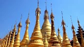 inlay : The golden pagodas of Buddhist monastery in Hang Si village are topped with ornate hti umbrellas, Taunggyi, Myanmar.