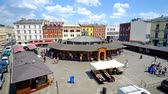 krakow : KRAKOW, POLAND - JUNE 21, 2018: The view on flea market stalls of New Square (Plac Nowy), located in Kazimierz Jewish Quarter with historical mansions on background, on June 21 in Krakow.