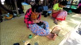 rendilhado : BAGAN, MYANMAR - FEBRUARY 25, 2018: Traditional lacquerware workshop is open for tourists to represent long and hard process of creating authentic Burmese lacquer pieces, on February 25 in Bagan.