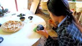 gravür : BAGAN, MYANMAR - FEBRUARY 25, 2018: The technique of eggshell inlay of the lacquer tableware in traditional lacquerware workshop, on February 25 in Bagan Stok Video
