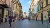 kapu : KRAKOW, POLAND - JUNE 11, 2018: Florianska street is popular shopping and walking area with numerous cafes, bars, stores and medieval St Florians Gate on background, on June 11 in Krakow.