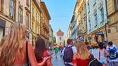 krakow : KRAKOW, POLAND - JUNE 11, 2018: The walk along theshopping Florianska street with its cafes and souvenir stores to historical St Florians Gate - the part of preserved rampart, on June 11 in Krakow.