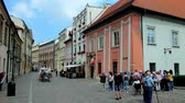 krakow : KRAKOW, POLAND - JUNE 11, 2018: The narrow Kanonicza street with preserved medieval palaces, mansions and museums is the notable tourist landmarks, located next to Wawel Castle, on June 11 in Krakow.
