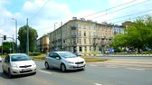 krakow : KRAKOW, POLAND - JUNE 11, 2018: The fast traffic in Jozef Dietl street next to the Grunwald Bridge over the Vistula river, on June 11 in Krakow. Stock Footage