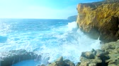 calcário : The tall cliffs at the former Azure Window site are best place to watch the storm, the strong foamy waves crash against the rocks with roar, San Lawrenz, Gozo Island, Malta.