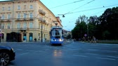 i city : KRAKOW, POLAND - JUNE 11, 2018: The evening urban scene with blue tram on the crossroad in Old Town (Stare Miasto), on June 11 in Krakow.