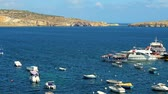 estaleiro : BUGIBBA, MALTA - JUNE 14, 2018: The pleasure boat with tourists departures for the trip along the coast of St Pauls Bay, on June 14 in Bugibba.