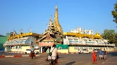 yangon : YANGON, MYANMAR - FEBRUARY 17, 2018: Panorama of the golden Sule Pagoda, surrounded by market stores and wide automobile road, on February 17 in Yangon.