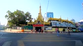 yangon : YANGON, MYANMAR - FEBRUARY 17, 2018: Medieval Sule Pagoda is hidden behind the market stalls, serving as defensive wall against the noise and dust of urban Maha Bandula road, on February 17 in Yangon.