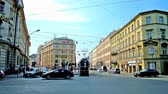 krakow : KRAKOW, POLAND - JUNE 11, 2018: The busy traffic in Westerplatte street with riding modern city trams, on June 11 in Krakow. Stock Footage