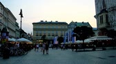 bell tower : KRAKOW, POLAND - JUNE 11, 2018: Evening Main Market Square (Rynek Glowny) is the best place to visit local restaurant or cafe, enjoy traditional cuisine and taste craft beer, on June 11 in Krakow.