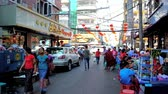 shabby : YANGON, MYANMAR - FEBRUARY 17, 2018: Crowded street of Chinatown with tiny cafes, offering local street food, market stalls and busy Maha Bandula Road on the foreground, on February 17 in Yangon.