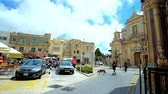 gruta : RABAT, MALTA - JUNE 16, 2018: Architectural ensemble of San Pawl Square with old edifices, outdoor cafes and beautiful building of Collegiate church of St Paul, on June 16 in Rabat. Vídeos