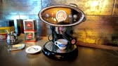 probuzení : NAPLES, ITALY - SEPTEMBER 19, 2018: Preparing of waking cup of morning espresso in luxury vintage styled FrancisFrancis home coffee machine with Illy ESE coffee pod, on September 19 in Naples.