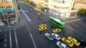 bairro : TEHRAN, IRAN - OCTOBER 25, 2017: Numerous yellow and green taxi cars in chaotic traffic along the busy city streets of Amir Kabir and Pamenar, on October 25 in Tehran.