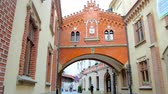 arsenal : KRAKOW, POLAND - JUNE 12, 2018: Walk Pijarska street under the covered pass of Czartoryski Palace with carved decorative elements, on June 12 in Krakow