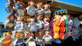 máltai : MARSAXLOKK, MALTA - JUNE 18, 2018: Colorful textile dolls for kitchen in souvenir store of handicraft market, stretching along the Xatt Is-Sajjieda seaside promenade, on June 18 in Marsaxlokk.