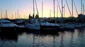 parroquia : The view from marina on the silhouettes of yachts sails and Msida Parish Church in last sunset rays, Malta.