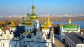 bizantino : Great Bell Tower of Kiev Pechersk Lavra is the best place to watch the city skyline with stunning Dormition Cathedral and Refectory Church of Lavra monastery and Dnieper river on background, Ukraine. Vídeos