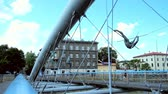 wisła : KRAKOW, POLAND - JUNE 21, 2018: Details of metal construction of modern Father Bernatek bridge across the Vistula river, decorated with acrobatic gravity-defying sculptures, on June 21 in Krakow.