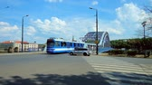 krakow : KRAKOW, POLAND - JUNE 21, 2018: The traffic in Krakowska street, the tram rides along Marshal Jozef Pilsudski bridge across the Vistula river, on June 21 in Krakow. Stock Footage