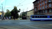 krakow : KRAKOW, POLAND - JUNE 21, 2018: The busy Jozef Dietl avenue with tramlines and heavy traffic separates Kazimierz neighborhood from the Old Town, on June 21 in Krakow. Stock Footage