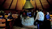 karpaty : SYNEVYR, UKRAINE - JULY 1, 2018: Interior of traditional Ukrainian restaurant in wooden house - koluba with fireplace in the middle of hall and tables on the sides, on July 1 in Synevyr. Dostupné videozáznamy