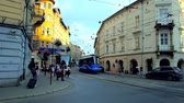 tram : KRAKOW, POLAND - JUNE 21, 2018: The blue trams drive along historic edifices in Krakowska street of Kazimierz, on June 21 in Krakow.