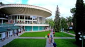 karpaty : MORSHYN, UKRAINE - JULY 2, 2018: The circle building of the pump room of spa resort with scenic green garden around it, on July 2 in Morshyn.