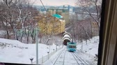 下段 : KIEV, UKRAINE - DECEMBER 19, 2018: The best way to enjoy snowy winter day is to take a ride on Funicular tram and explore old town, on December 19 in Kiev