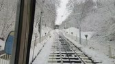 funicular : The best way to enjoy snowy winter day is to take a ride on Funicular tram and explore old town, on December 19 in Kiev