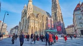 viyana : VIENNA, AUSTRIA - FEBRUARY 17, 2019: The numerous tourists in St Stephen Square (Stephansplatz) at the outstanding St Stephen Cathedral (Stephansdom or Domkirche), on February 17 in Vienna.